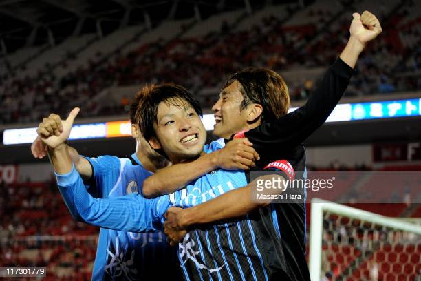 Yu Kobayashi celebrates second goal of Kawasaki Frontale with Junichi Inamoto during JLeague match between Kashima Antlers and Kawasaki Frontale at...