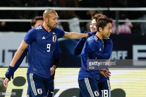 Yu Kobayashi of Japan celebrates a point during the EAFF E1 Men's Football Championship between Japan and China at Ajinomoto Stadium on December 12...