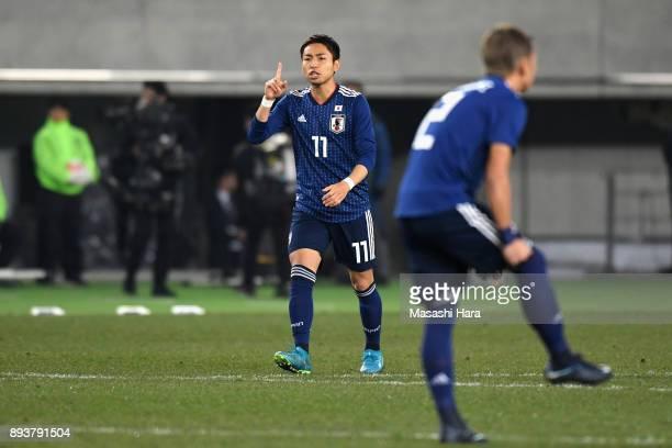 Yu Kobayashi of Japan celebrates scoring the openg goal during the EAFF E1 Men's Football Championship between Japan and South Korea at Ajinomoto...