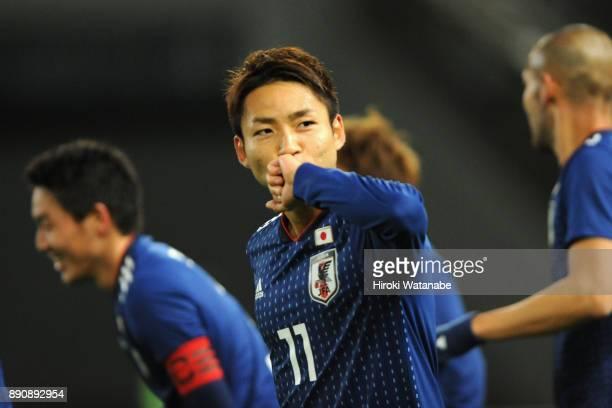 Yu Kobayashi of Japan celebrates scoring the opening goal during the EAFF E1 Men's Football Championship between Japan and China at Ajinomoto Stadium...