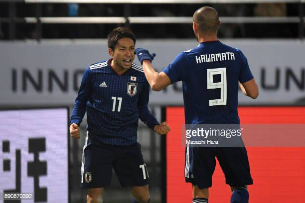 Yu Kobayashi of Japan celebrates scoring the opening goal with his team mate Kengo Kawamata during the EAFF E1 Men's Football Championship between...