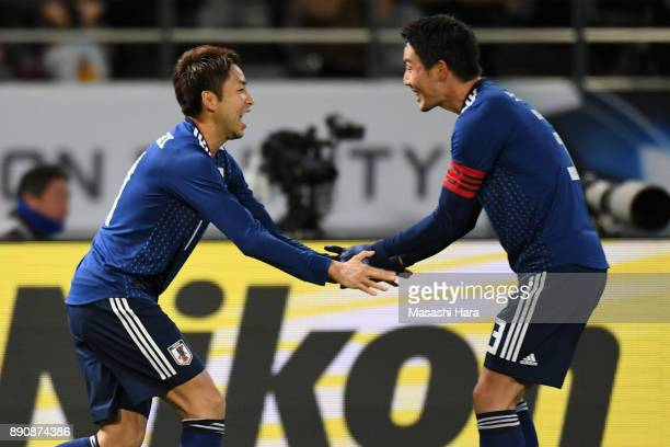 Yu Kobayashi of Japan celebrates scoring the opening goal with his team mate Gen Shoji during the EAFF E1 Men's Football Championship between Japan...