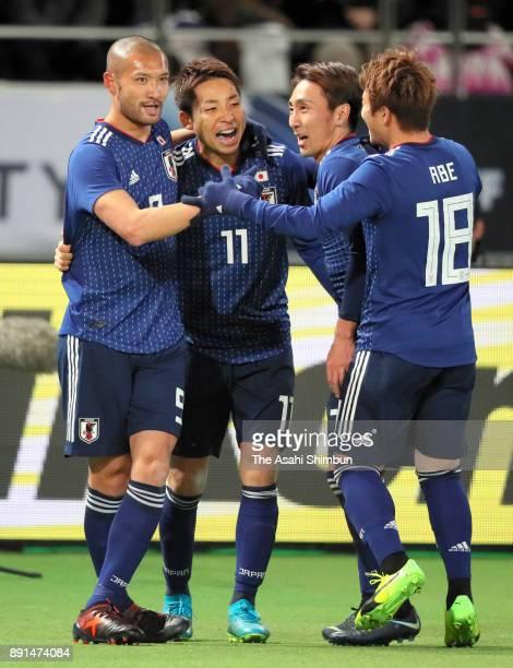 Yu Kobayashi of Japan celebrates scoring the opening goal with his team mates during the EAFF E1 Men's Football Championship between Japan and China...