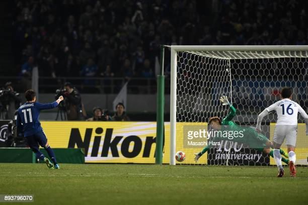 Yu Kobayashi of Japan converts the penalty to score the opening goal during the EAFF E1 Men's Football Championship between Japan and South Korea at...