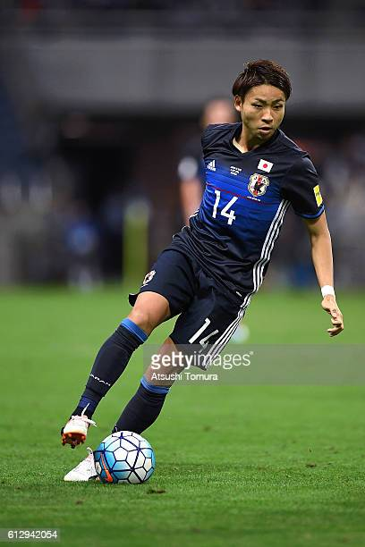 Yu Kobayashi of Japan dribbles during the 2018 FIFA World Cup Qualifiers match between Japan and Iraq at Saitama Stadium on October 6 2016 in Saitama...