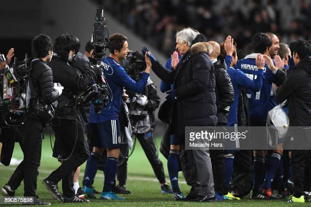 Yu Kobayashi of Japan is congratulated by head coach Vahid Halilhodzic after their 21 victory in the EAFF E1 Men's Football Championship between...