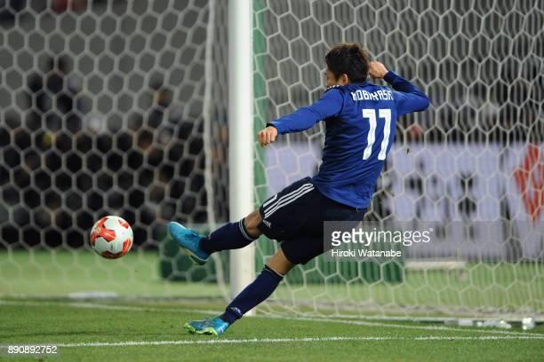 Yu Kobayashi of Japan scores the opening goal during the EAFF E1 Men's Football Championship between Japan and China at Ajinomoto Stadium on December...