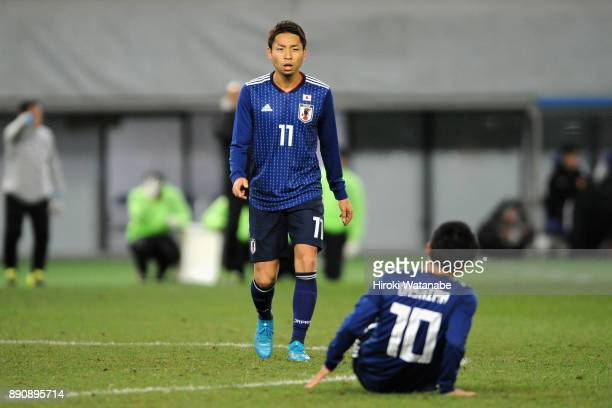 Yu Kobayashi of Japan talks to Ryota Oshima during the EAFF E1 Men's Football Championship between Japan and China at Ajinomoto Stadium on December...