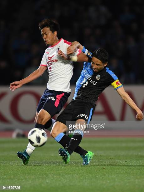 Yu Kobayashi of Kawasaki Frontale and Yusuke Maruhashi of Cerezo Osaka compete for the ball during the JLeague J1 match between Kawasaki Frontale and...