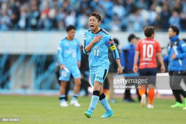 Yu Kobayashi of Kawasaki Frontale celebartes his side's 50 victory and the JLeague Champions after the JLeague J1 match between Kawasaki Frontale and...