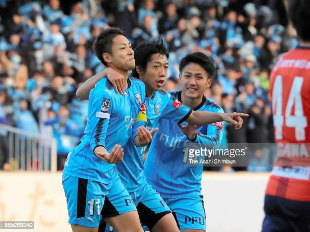 Yu Kobayashi of Kawasaki Frontale celebrates scocring his side's fourth and hat trick goal with his team mates Kengo Nakamura and Ryota Oshima during...