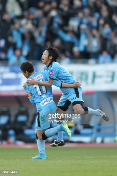 Yu Kobayashi of Kawasaki Frontale celebrates scoring his side's fourth and his hat trick goal with hsi team mate Kengo Nakamura during the JLeague J1...