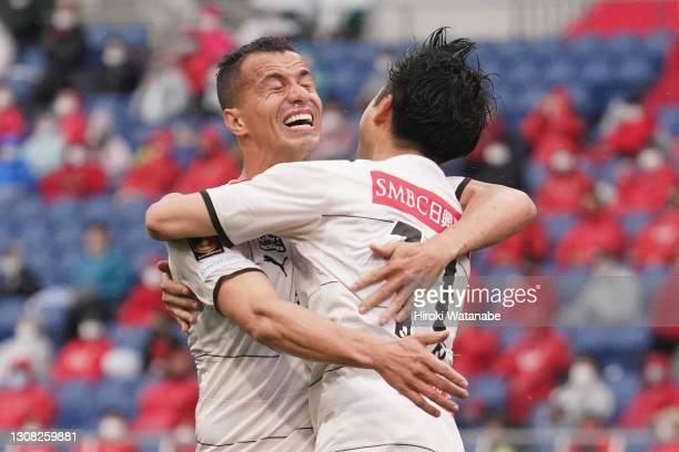 Yu Kobayashi of Kawasaki Frontale celebrates scoring his team's first goal during the J.League Meiji Yasuda J1 match between Urawa Red Diamonds and...