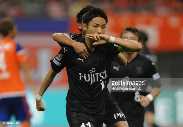 Yu Kobayashi of Kawasaki Frontale celebrates scoring the opening goal with his team mate Tatsuya Hasegawa during the J.League J1 match between...