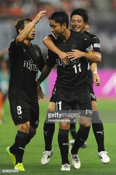 Yu Kobayashi of Kawasaki Frontale celebrates scoring the opening goal with his team mates Tatsuya Hasegawa and Hiroyuki Abe during the JLeague J1...