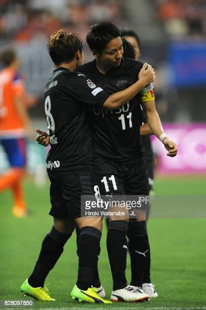 Yu Kobayashi of Kawasaki Frontale celebrates scoring the opening goal with his team mates Tatsuya Hasegawa and Hiroyuki Abe during the J.League J1...