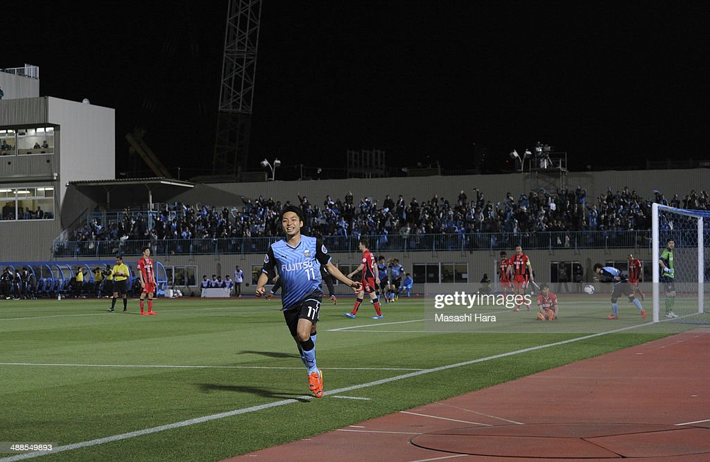 Yu Kobayashi #11 of Kawasaki Frontale celebrates the first goal during the AFC Champions League Round of 16 match between Kawasaki Frontale and FC Seoul at Todoroki Stadium on May 7, 2014 in Kawasaki, Japan.