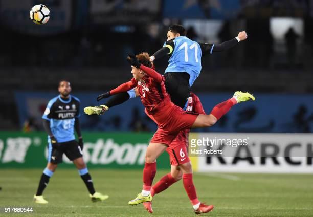 Yu Kobayashi of Kawasaki Frontale heads the ball against Shi Ke of Shanghai SIPG during the AFC Champions League Group F match between Kawasaki...