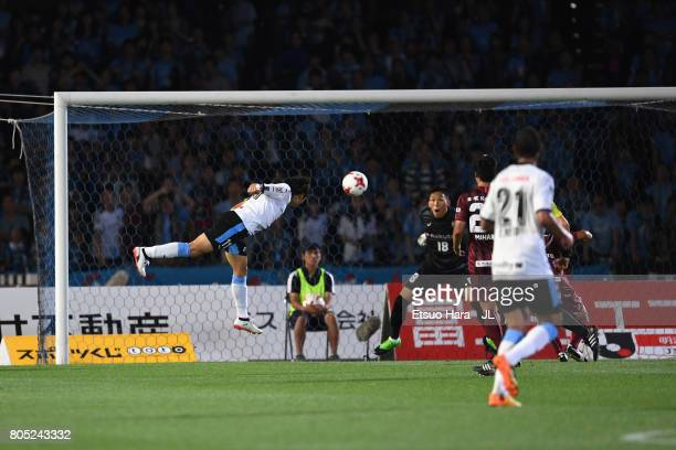 Yu Kobayashi of Kawasaki Frontale heads to score his side's third goal during the JLeague J1 match between Kawasaki Frontale and Vissel Kobe at...