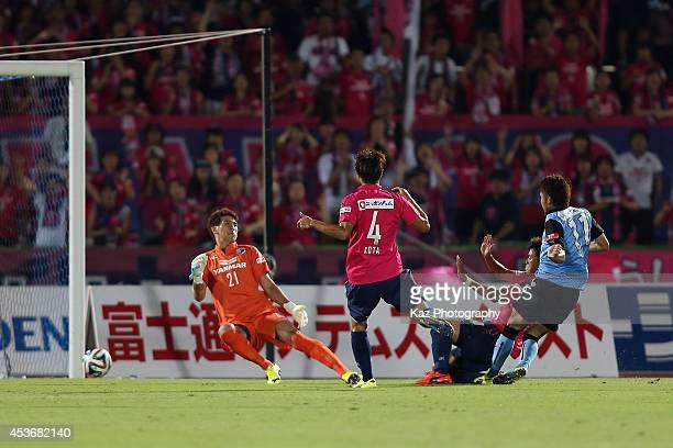 Yu Kobayashi of Kawasaki Frontale scores his team's first goal during the J.League match between Kawasaki Frontale and Cerezo Osaka at Todoroki...