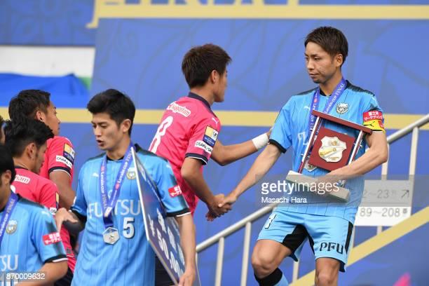 Yu Kobayashi of kawasaki Frontale shakes hands with Yoichiro Kakitani after the JLeague Levain Cup final match between Cerezo Osaka and Kawasaki...