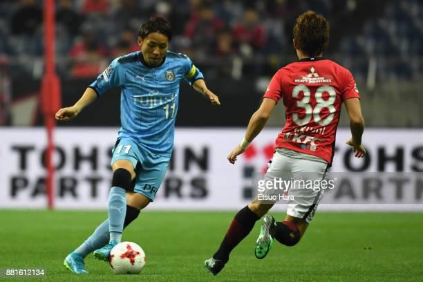 Yu Kobayashi of Kawasaki Frontale takes on Daisuke Kikuchi of Urawa Red Diamonds during the J.League J1 match between Urawa Red Diamonds and Kawasaki...
