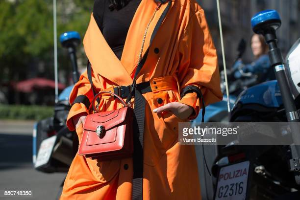 Yu Lee poses with a Bulgari bag after the Fendi show during Milan Fashion Week Spring/Summer 2018 on September 21 2017 in Milan Italy