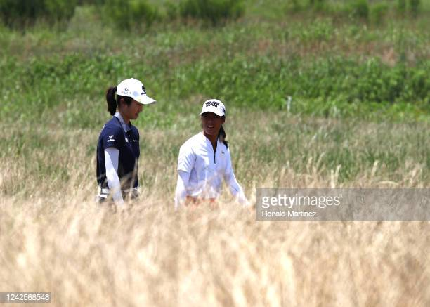 Yu Liu of China and Celine Boutier of France walk to the first green during the first round of the Energy Producers Inc Texas Women's Open on June 02...