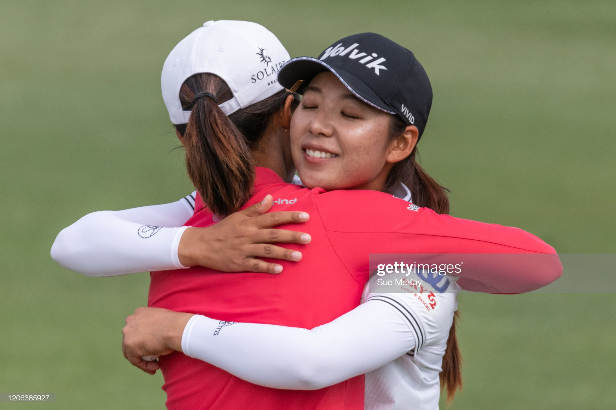 https://media.gettyimages.com/photos/yu-liu-of-china-and-mi-hyang-lee-of-korea-embrace-at-the-end-of-day-picture-id1206385927?s=2048x2048