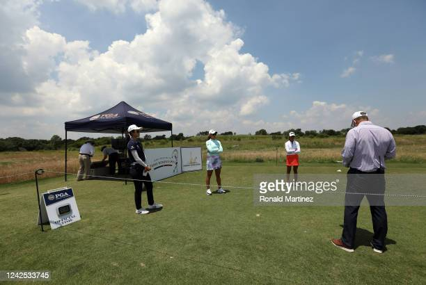 Yu Liu of China Maria Fassi of Mexico and Celine Boutier of France keep a distance as they wait to tee from the first hole during the first round of...
