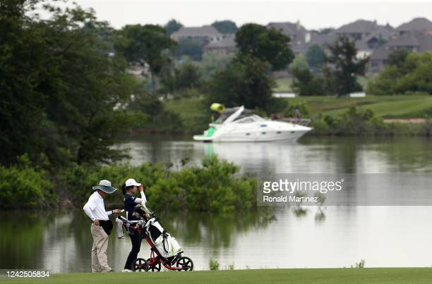 Yu Liu of China uses a rangefinder on the 9th hole during the first round of the Energy Producers Inc Texas Women's Open on June 02 2020 in The...