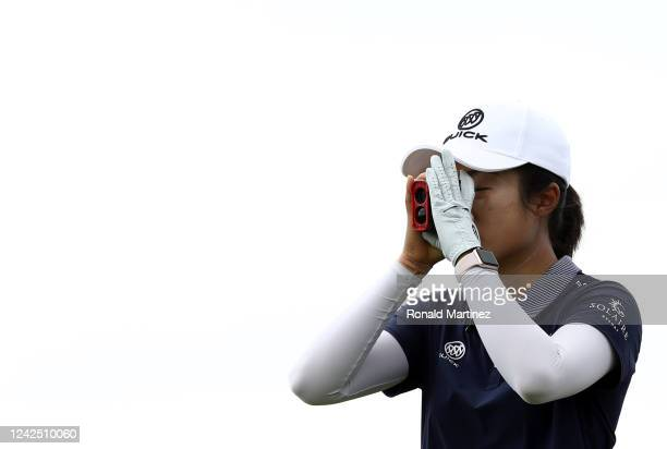 Yu Liu of China uses a rangefinder on the 9th tee during the first round of the Energy Producers Inc Texas Women's Open on June 02 2020 in The Colony...