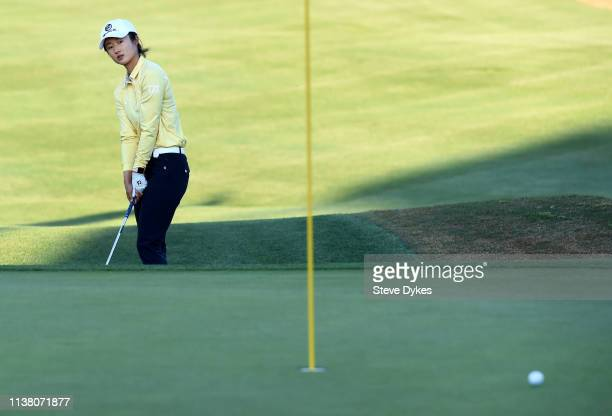 Yu Liu of China watches her chip shot roll past the hole on the 18th green during the final round of the Bank Of Hope Founders Cup at the Wildfire...