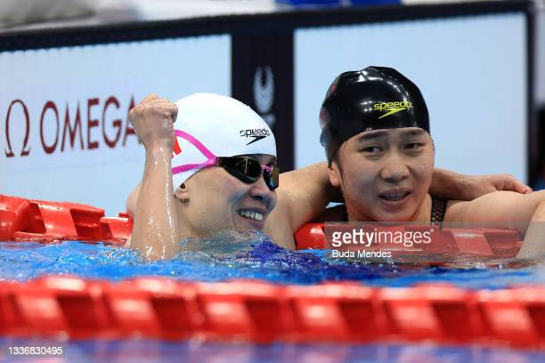 Yu Liu of Team China reacts after winning the gold medal as silver medalist Yanfei Zhou of Team China watches on after the Women's 150m Individual...