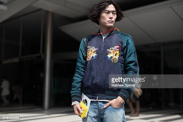 Yu Masui attends the Tokyo New Age show during Tokyo Fashion Week wearing a Doublet coat Ami jeans Acne Studios bag and Myswear shoeson March 18 2016...