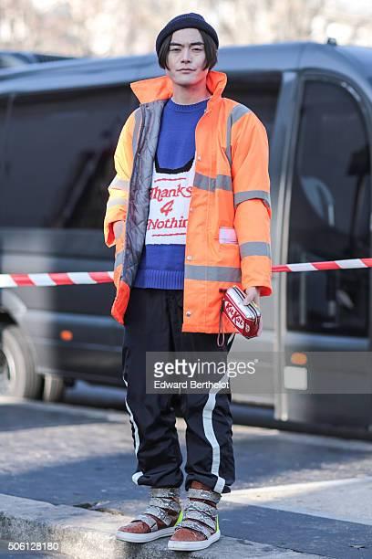 Yu Masui wearing an Anya Hindmarch bag after the Rick Owens show during Paris Fashion Week Menswear Fall Winter 2016/2017 on January 21 2016 in Paris...