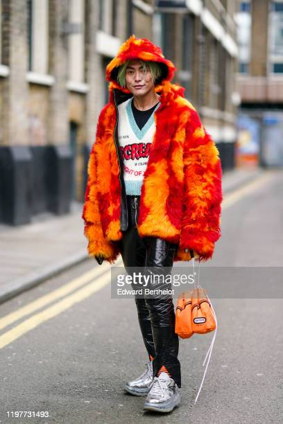 Yu Masui wears an orange and red fluffy hat a fluffy jacket a white and blue Vneck wool pullover a black tshirt black leather shiny pants Bump'Air...