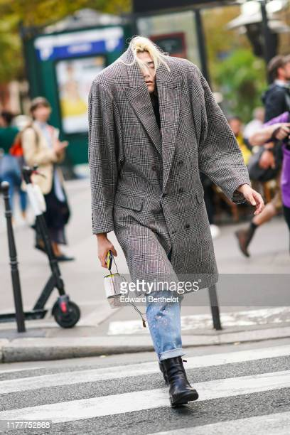 Yu Masui wears an oversized blazer long jacket with printed checked pattern outside CDG Comme des Garçons during Paris Fashion Week Womenswear Spring...