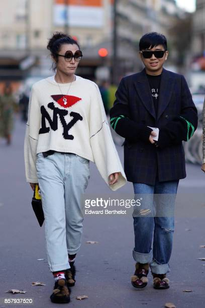 Yu Masui wears sunglasses a 'NY' white pull over blue jeans 'boyfriend' Declan Chan wears sunglasses a blazer jacket with green embroidery ripped...