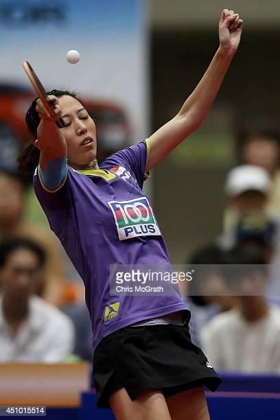 Yu Mengyu of Singapore returns a shot against Ishikawa Kasumi of Japan during their Women's Singles Semi final match on day three of 2014 ITTF World...