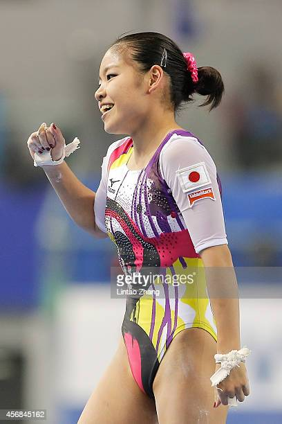 Yu Minobe of Japan celebrates after competing on the uneven bars during the Women's Team Final on day two of the 45th Artistic Gymnastics World...