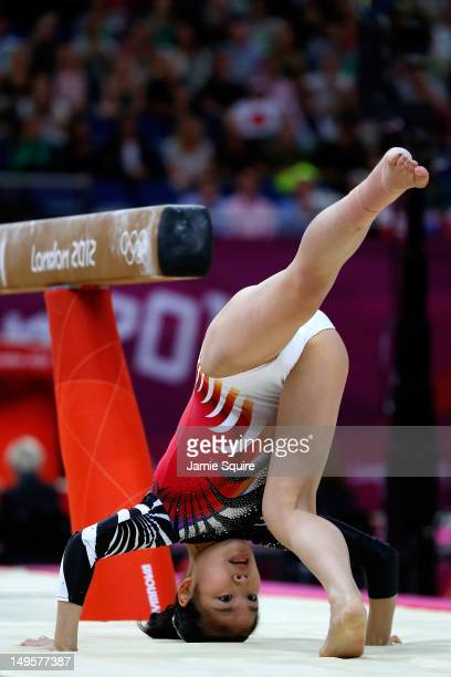 Yu Minobe of Japan lands on her head during the dismount on the balance beam in the Artistic Gymnastics Women's Team final on Day 4 of the London...