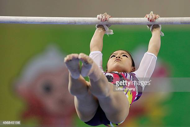Yu Minobe of Japan performs on the uneven bars during the Women's Team Final on day two of the 45th Artistic Gymnastics World Championships at...
