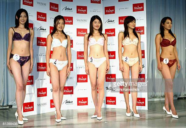 Yu Misaki the newly named image girl of lingerie maker Triumph International Japan lines up with her contestants as they pose for the press September...