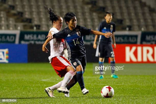 Yu Nakasato of Japan is tackled by Geraldine Reuteler of Switzerland during the international friendly match between Japan and Switzerland at Nagano...