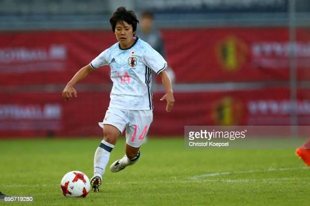 Yu Nakasato of Japan runs with the ball during the Women's International Friendly match between Belgium and Japan at Stadium Den Dreef on June 13...