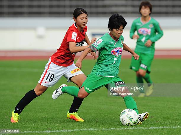 Yu Nakasato of NTV Beleza and Shiokoshi yuzuho of Urawa Red Diamonds compete for the ball during the Nadeshiko League match between Urawa Red...