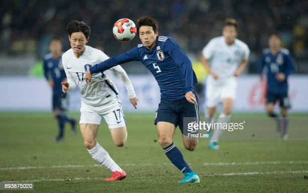 Yu of Japan and Jung Wooyoung of South Korea in action during the EAFF E1 Men's Football Championship between Japan and South Korea at Ajinomoto...