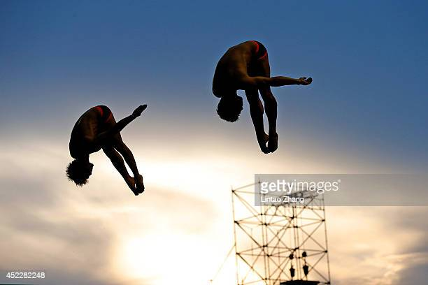 Yu Okamoto and Ken Terauchi of Japan compete on in the Men's 3m Springboard Final during day three of the 19th FINA Diving World Cup at the Oriental...
