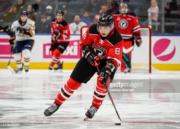 Yu Sato of the Quebec Remparts skates with the puck against the Shawinigan Cataractes during their QMJHL hockey game at the Videotron Center on...